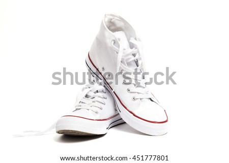 Pair of new white sneakers isolated on white background.