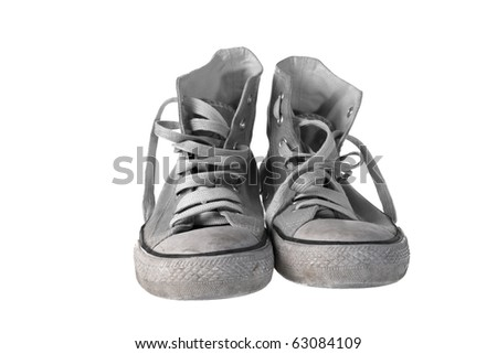 Pair of old and dirty sneakers , isolated on white - stock photo