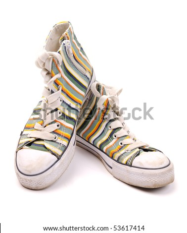 Pair of old dirty fashionable sneakers, isolated on white background. - stock photo