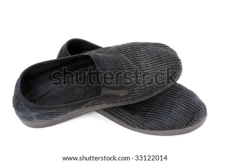 Pair of old slipper in front of white background