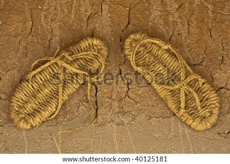 pair of old straw sandals - stock photo