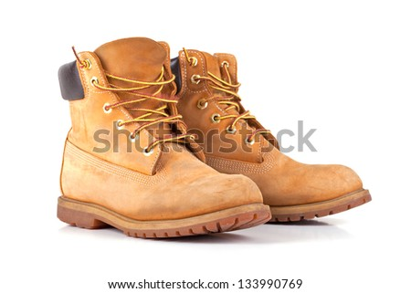 Pair of old yellow working boots Isolated on white background - stock photo