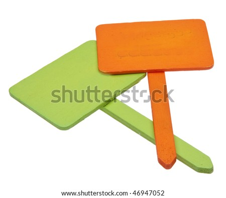 Pair of orange and green garden signs or stakes isolated on white with a clipping path.