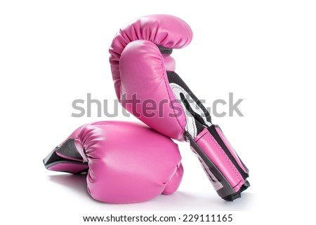 Pair of pink boxing gloves isolated on white - stock photo