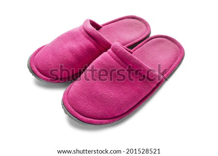 Pair of pink slippers on white background closeup - stock photo