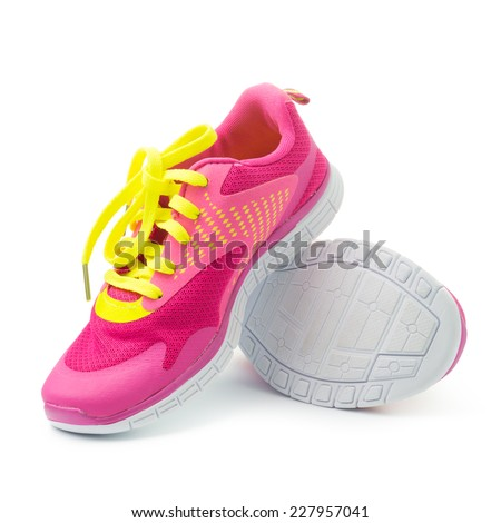 Pair of pink sport shoes on white background - stock photo