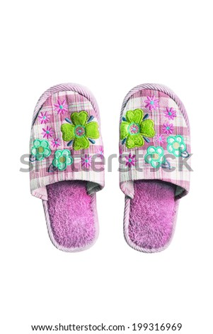 Pair of pink textile home slippers isolated over white - stock photo