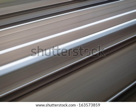 Pair of railroad tracks at high speed - stock photo