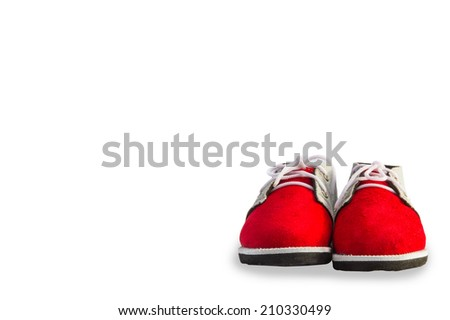 Pair of red baby shoes isolated on white background.