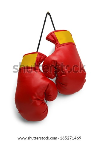 Pair of Red Boxing Gloves Hanging Isolated on White Background. - stock photo