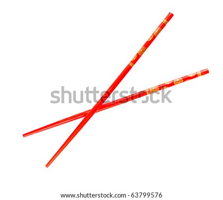 Pair of red chopsticks isolated on white background - stock photo
