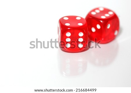 pair of red dice -  reflected on white background - stock photo