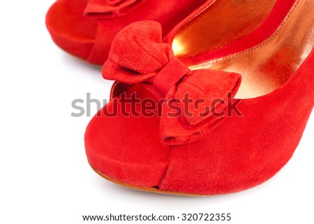 Pair of red female shoes over white background - stock photo