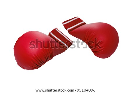 Pair of red kick boxing gloves isolated on white background