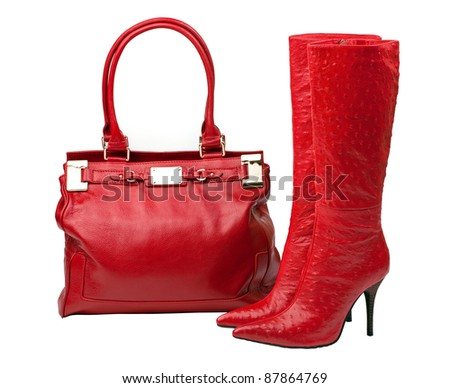 Pair of red knee-high boots and female bag isolated over white, with clipping path - stock photo