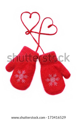Pair of red knitted mittens with a entwined romantic red heart. Isolate on white. Love and St. Valentine concept. - stock photo