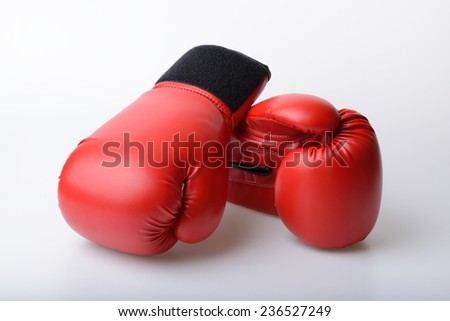 Pair of red leather boxing gloves on white background - stock photo