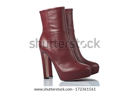 pair of red leather female high heel  boots. isolated on white