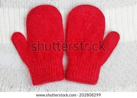 pair of red mittens  - stock photo
