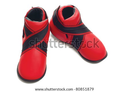 Pair of red sport shoes isolated over pure white background
