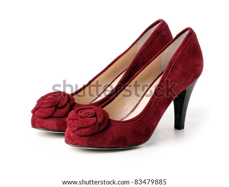 Pair of red suede female shoes over white - stock photo
