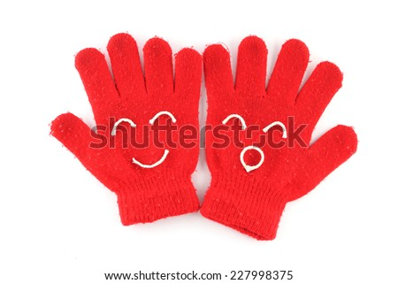 Pair of red winter gloves with happy face - stock photo