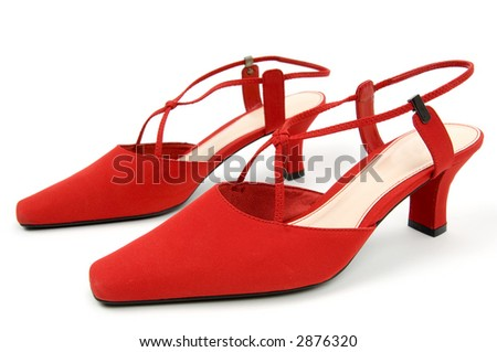 Pair of red women's high heel shoes isolated on white background.  Highly detailed focus on closest shoe.