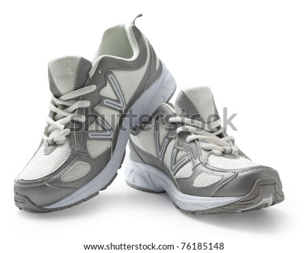 Pair of running shoes isolated in white background. With clipping path. - stock photo