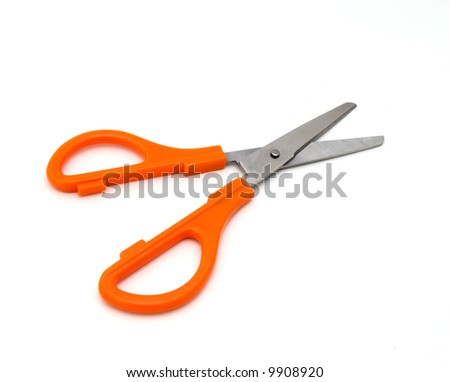 pair of scissors on a white surface