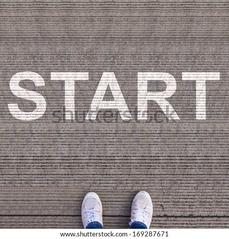 Pair of shoes standing on walkway with start - stock photo