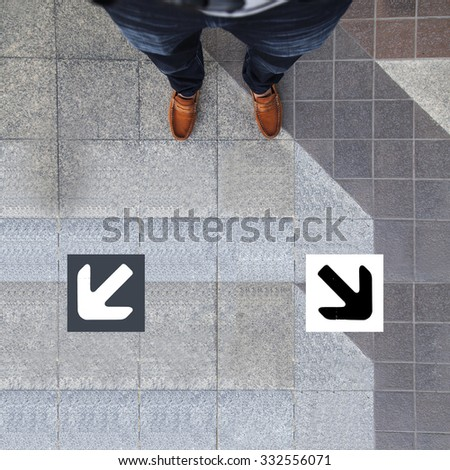 Pair of shoes standing with two arrow - stock photo
