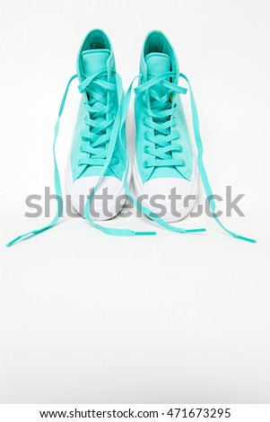 Pair of shoes with long laces untied