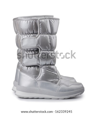 Pair of silver winters snow boots isolated on white - stock photo