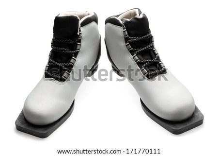 Pair of ski boots on white background - stock photo