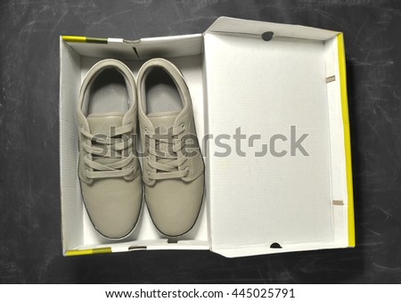 pair of sneakers in a box - stock photo