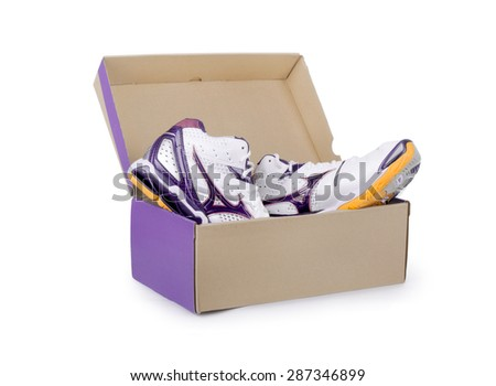 Pair of sneakers in shoe cardboard box isolated on white backgro - stock photo