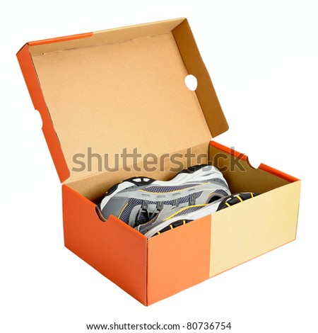Pair of sneakers in shoe cardboard box isolated on white background - stock photo