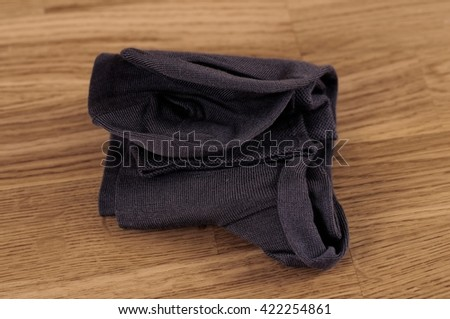 Pair of socks on the wooden background. Vintage photo filter applied. Selective focus. - stock photo