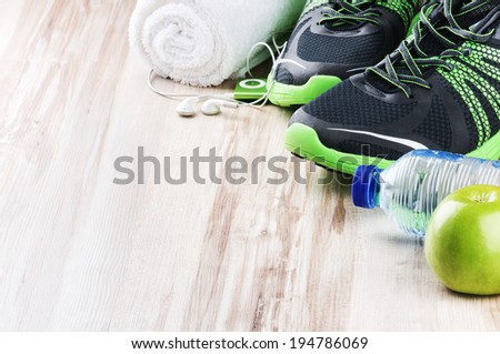 Pair of sport shoes and fitness accessories - stock photo