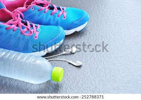Pair of sport shoes and fitness accessories. - stock photo