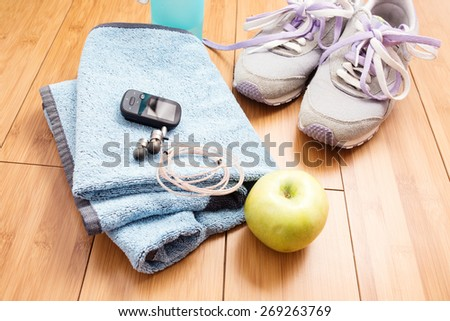 Pair of sport shoes and fitness accessories. Fitness concept - stock photo