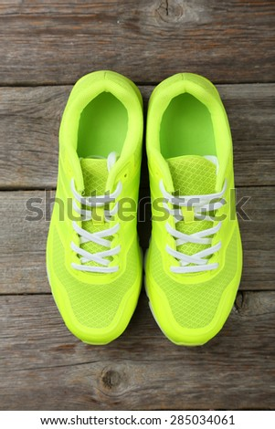 Pair of sport shoes on grey wooden background - stock photo