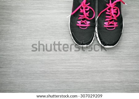 Pair of sport shoes on grey wooden background, Sport wear, Sport fashion, Sport accessories, Sport equipment. - stock photo