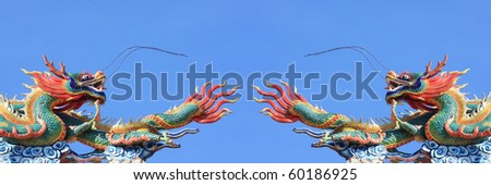pair of statue dragon on blue sky background