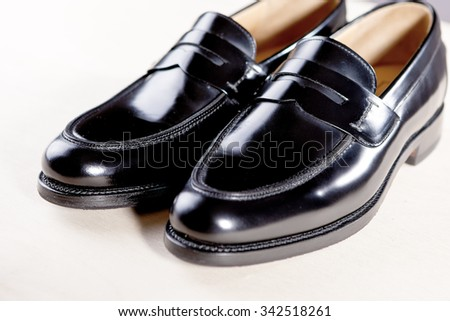 Pair of Stylish Expensive Modern Leather Black Penny Loafers Shoes.Closeup Shot. Horizontal  Image Concept