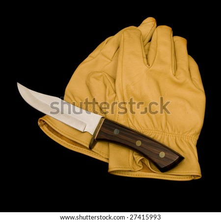 Pair of tan leather work gloves and a fixed blade knife, black iso.