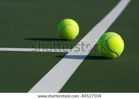 Pair of Tennis Balls near the Court Lines - stock photo