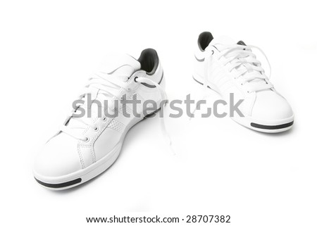 Pair of tennis sneakers over the white background - stock photo