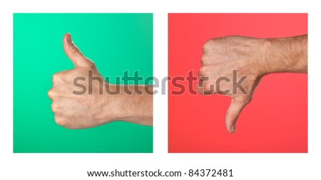 Pair of Thumbs up and Thumbs Down Signs on Green and Red Background - stock photo