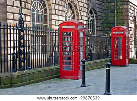 Pair of traditional British telephone boxes - stock photo